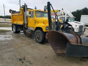 International single axle dump truck with snow plow and sander