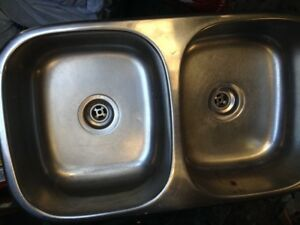 Stainless steel kitchen sink with new drains
