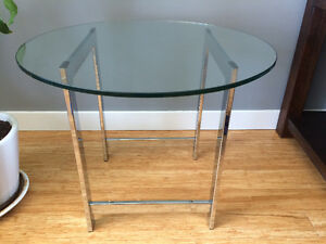 Two round glass end tables