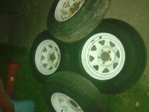 4 Carlisle 14 inch trailer tires and spoked wheels 215 75 14