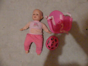 Doll with Bike seat and Helmet