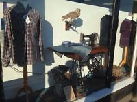 Motion activated antique treadle sewing machine and turntable