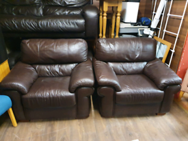14. Pair of brown leather armchairs