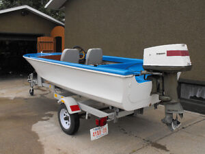 14 Ft. Fiberglass boat with trailer and motor