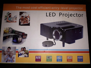 Brand new in box LED projector 80$