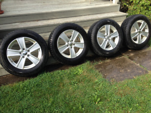 4 WINTER TIRES WITH ALUMINUM RIMS