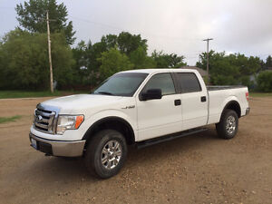 """Ford F150 18"""" rims & tires - Swan River."""