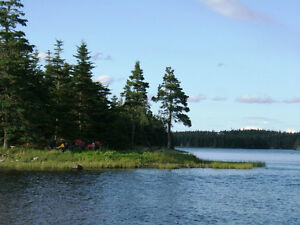 Beautiful waterfront lot on the Grand River, Cape Breton Island