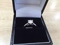 Single stone diamond ring platinum 4 claw engagement ring
