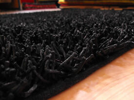 new black 100% polyester heavy and hardwearing cloth backing rug