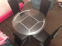 Round glass table and chairs