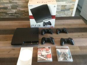 PS3 Slim 120 Go avec 4 manettes et 5 jeux