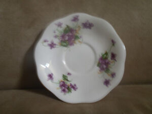 Tea saucers missing their cups