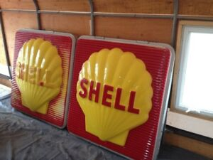 2 large shell gas sign