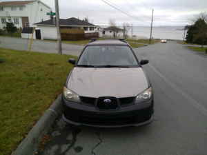 AWD,Winters on rims,Low KMS,Rem Start,Bluetooth,Cam,2Tone,RRack