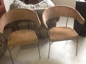 Wrought iron and wicker (resin) chairs