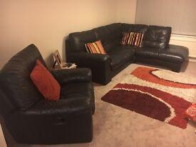 DFS black leather corner sofa & armchair recliner
