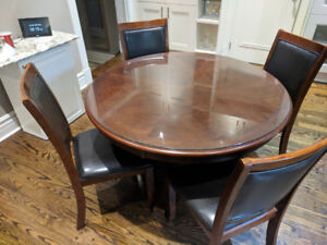 Wooden Circular Breakfast Table with four leather chairs