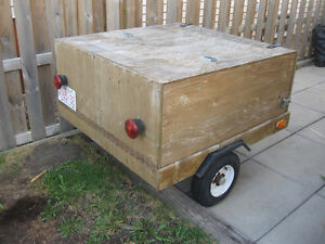 Clam style utility trailer