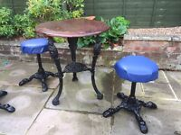 Cast iron pub table and stools