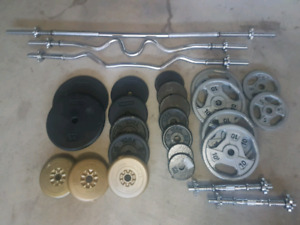 295lbs+ weight plates with bars 2 benches and alot more.