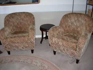 Two small living-room upholstered arm chairs