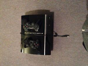 Playstation3 500G avec 2 manettes et choix de jeux West Island Greater Montréal image 1