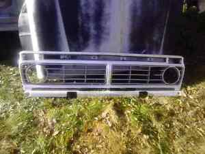 $120 Ford Grill1973to1979 in good shape and a windshield