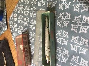 Old metal tackle box with lures and reel