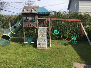 Swing set with rock climbing