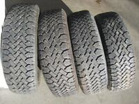 4- Used P205/70R14 Studded winter tires like new with snowflake