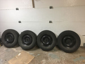 Winter tires Cooper Discoverer 215/70r16 with rims.