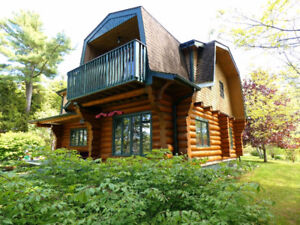 """Stunning LOG HOUSE for sale with 200""""+ private Ocean Frontage"""