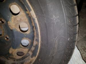Winter tires on rims. Pneus d'hiver sur jantes