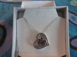 never worn, sterling silved dog paw in heart pendant