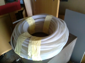 LARGE ROLL PLASTIC PIPE FOR SALE.