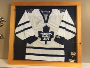A signed Toronto Maple Leaf jersey by the great  Darryl Sittler.