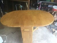 Drop leaf oak dining table