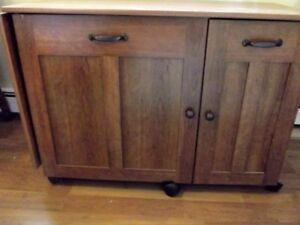 Cabinet  used as sewing table and for storing sewing machines