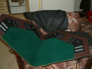 Poker table top folds up fits in a bag