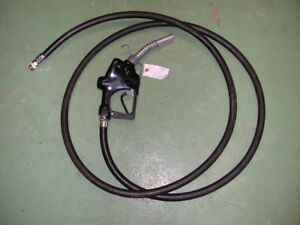 Fuel dispensing nozzle with hose