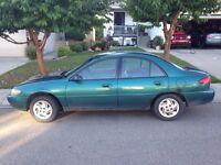 97 Ford Escort with extra tires