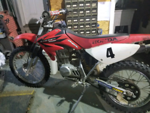 Wanted to trade 2006 Honda CRF 100 for somethin smaller.