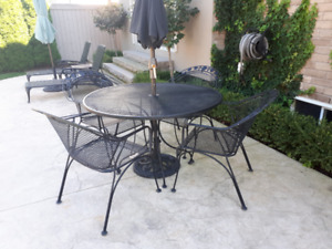 BLACK METAL PATIO TABLE WITH FOUR CHAIRS