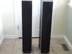 six Polk home theater speakers