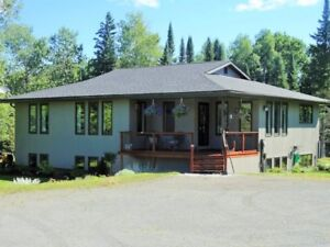39.5 Acre Country Home- Skidder Included!