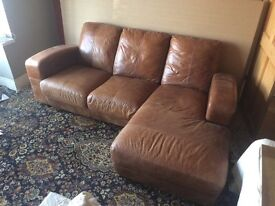 Brown leather L-shaped sofa