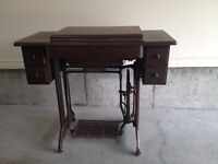 Antique circa 1883 Singer Sewing machine and cabinet