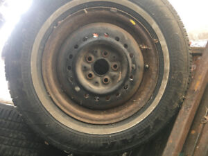 """Two sets of 14"""" tires and rims."""
