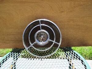 Clock with grille